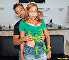 Big tits babe plays with a comic book nerds toys then gets her box and mouth fucked by his big dong